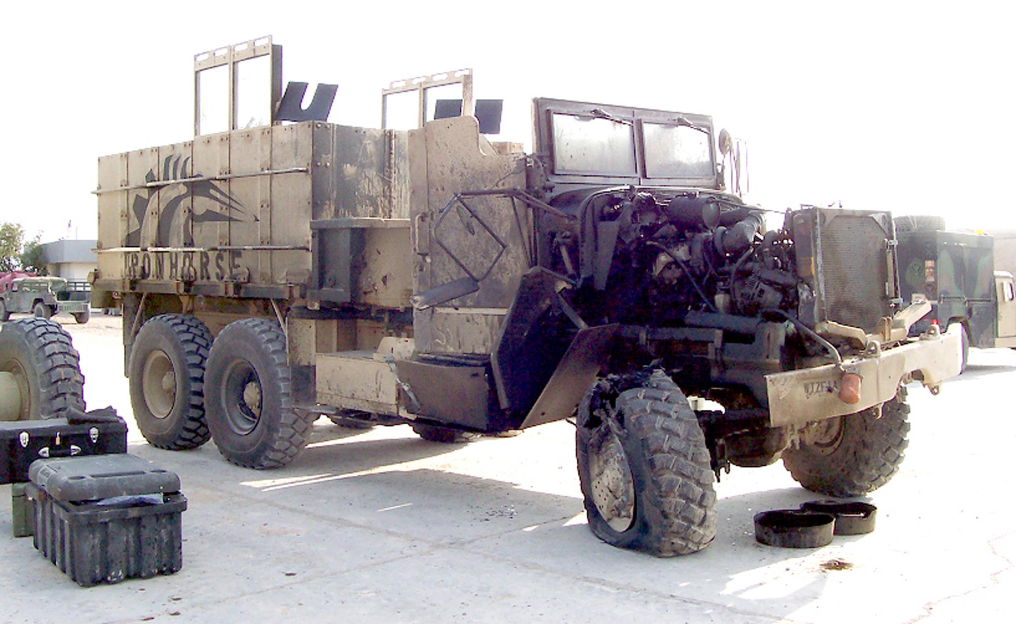 Iraq-gun_truck_hit_by_IED